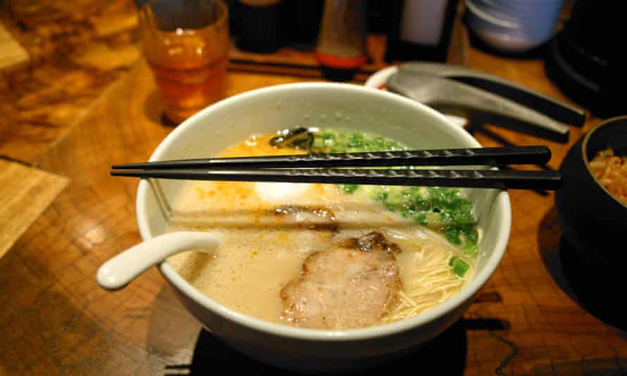 A bowl of hot ramen soup with chopsticks in Japan