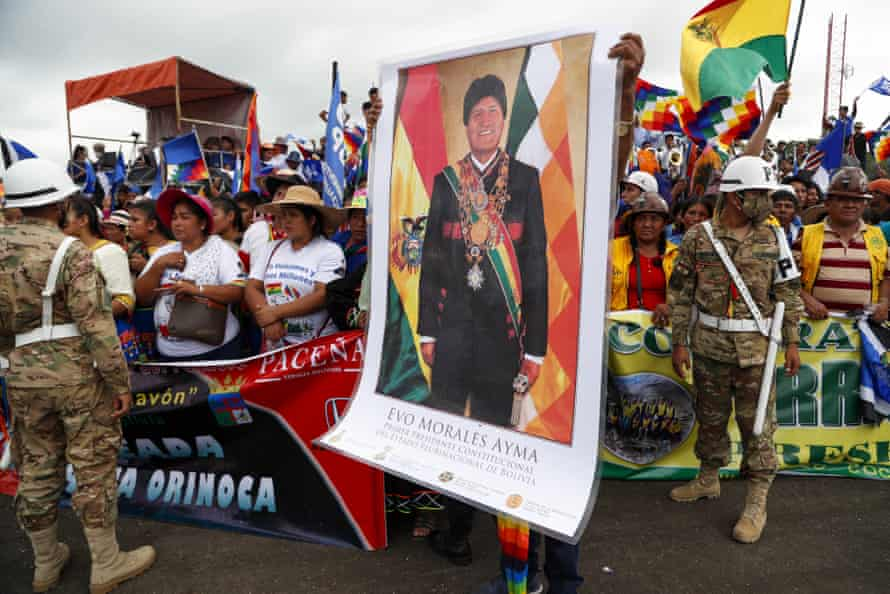 A supporter holds a poster of Morales during a rally to welcome him to Chimoré on 11 November.