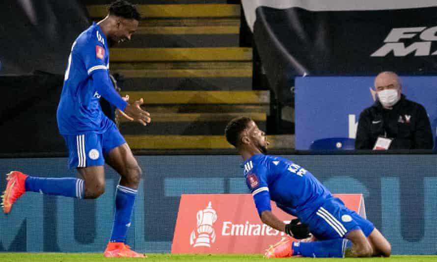 Kelechi Iheanacho celebrates Leicester's third goal.