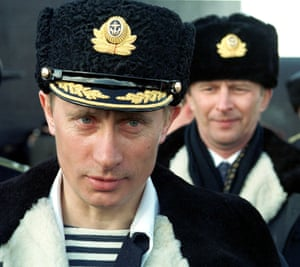 April 2000: Now president, Putin wears a navy officer's uniform while watching the tactical exercises of the Northern Fleet in the Barentsevo Sea