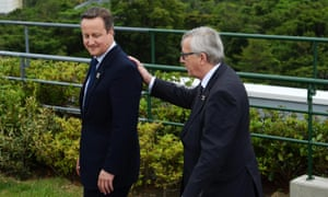 President of the European Commission Jean-Claude Juncker, right, places his hand on the back of British Prime Minister David Cameron as they leave the group photo session at the G-7 summit meetings in Shima, Japan, Thursday, May 26, 2016. (Sean Kilpatrick/The Canadian Press via AP) MANDATORY CREDIT
