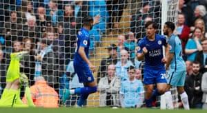Leicester City's Shinji Okazaki celebrates scoring their first goal.