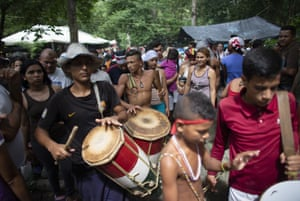 Followers play drums during a procession on Sorte Mountain. The gathering in honour of Maria Lionza is hundreds of years old and draws on Catholicism, Afro-Caribbean religion Santeria and indigenous rituals, all set to a pulse of constant drumming