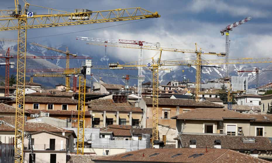 Cranes still dominate the skyline of L'Aquila a decade after it was hit by a deadly earthquake.
