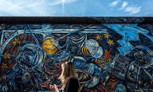 The East Side Gallery, a 0.8 miles (1.3km) stretch of the original Berlin Wall that remains as a monument.