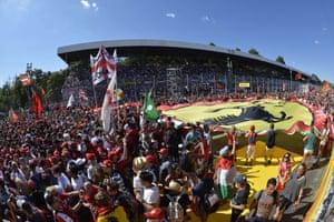 Tofosi fans celebrate with a giant banner, second for Ferrari's Sebastian Vettel.