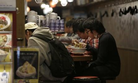 Customers at a small ramen shop near Shibuya station in April
