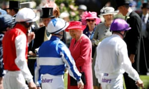 The Queen and racing advisor John Warren look on as the jockeys walk out before the start of the racing.