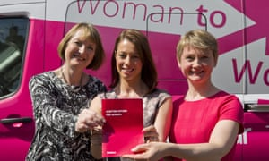 Harriet Harman, Gloria De Piero and Yvette Cooper hold up the Labour's women's manifesto in front of their pink bus.