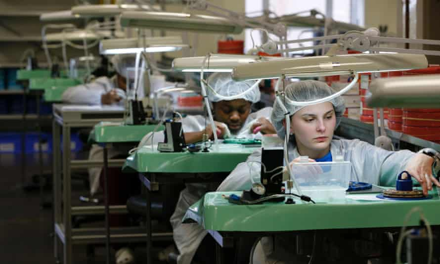 A worker at the Shinola Watch factory in Detroit. Economists suggested another interest rate rise was likely.