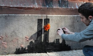 A Banksy work depicting the attack on the Twin Towers, photographed by a viewer in October 2013.