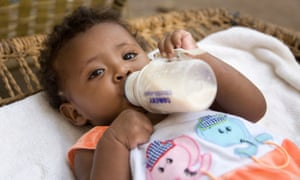 A baby in Eritrea drinks formula milk.
