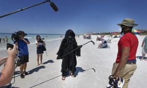 The Grim Reaper, aka Florida attorney Daniel Uhlfelder, talks to reporters.