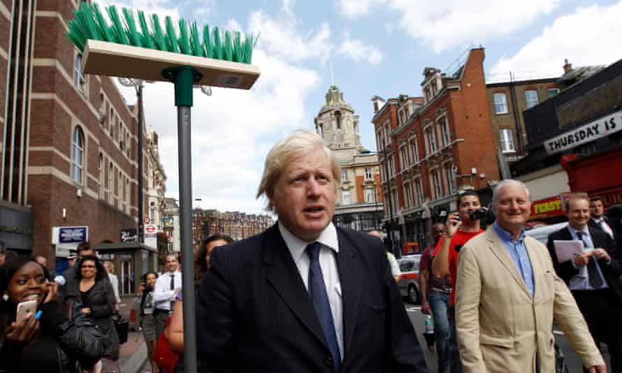 Boris Johnson with a broom after the London riots of 2011
