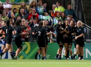 New Zealand's full-back Selica Winiata, third right, celebrates with team-mates after scoring her second try.