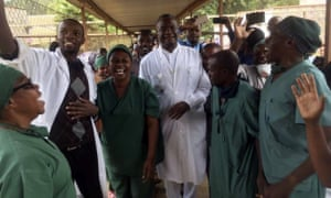 Denis Mukwege, centre, celebrates with his staff after learning he won the 2018 Nobel peace prize, at the Panzi hospital in Bukavu, eastern Congo.