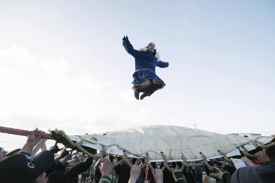 Successful whalers do the blanket toss. They are thrown up to thirty feet in the air, and depend on everyone's hands to land safely.