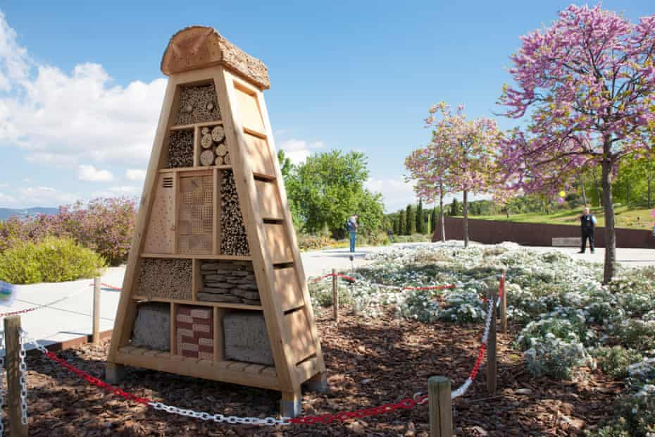 A wooden sculpture in the shape of a pyramid at Jardí Botànic de Barcelona, Spain.