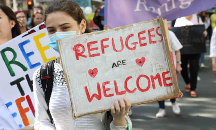 People rally in Sydney in March in support of refugees.