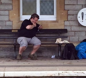 On train station bench