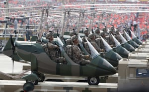 Chinese troops in military vehicles in Tiananmen Square