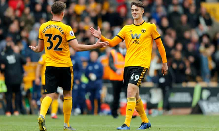 Max Kilman, right, is greeted by Leander Dendoncker as the former futsal international makes his Premier League debut for Wolves against Fulham in May.