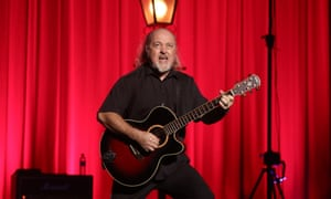 Bill Bailey playing the guitar on his Limboland tour.