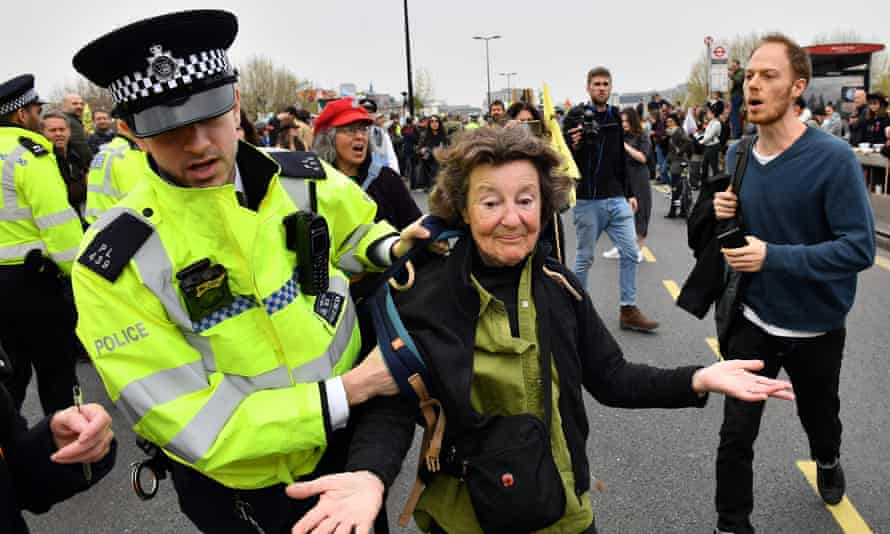 Police officers remove activists from an Extinction Rebellion blockade of Waterloo Bridge, in London, in April 2019.