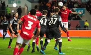 Nahki Wells heads home Bristol City's opening goal.