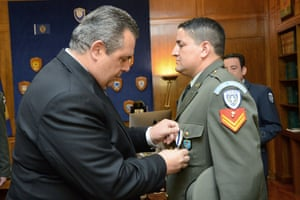 Greek army sergeant Antonis Deligiorgis is awarded the Cross of Excellency for his role in the rescue.