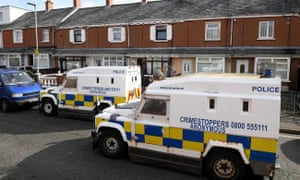 Police and forensic experts at the house where Robbie Lawlor was killed in Ardoyne on Saturday.