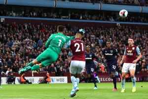 Lukasz Fabianski clears the ball and takes out Anwar El Ghazi.