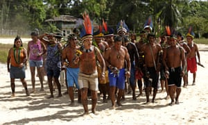 The Tenetehara Indigenous community holds a festival in the Alto Rio Guama Indigenous Reserve, where they have enforced six months of isolation during the new coronavirus pandemic, near the city of Paragominas, Brazil.