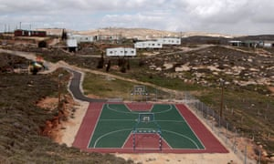A basketball court and houses in the illegal outpost of Amona, north of Ramallah.