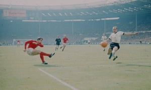During the first period of extra time Geoff Hurst shoots at goal, hitting the bar before the ball fired back down onto the line. The Russian linesman awards the goal sparking a controversy that rages to this day