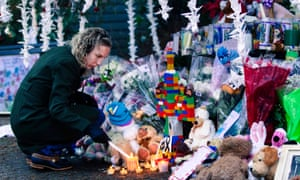A woman visits a memorial to the victims of the Sandy Hook shooting.