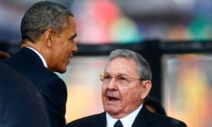 Barack Obama greets Cuba's president, Raul Castro, as Brazil's president, Dilma Rousseff, looks on, at the memorial service for Nelson Mandela in December 2013. The apparently accidental meeting was the culmination of six months' of secret talks.
