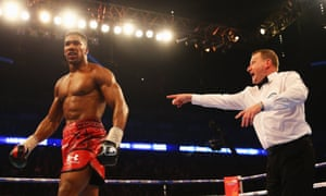 Anthony Joshua is ordered to a neutral corner after stopping Dillian Whyte in the seventh round.