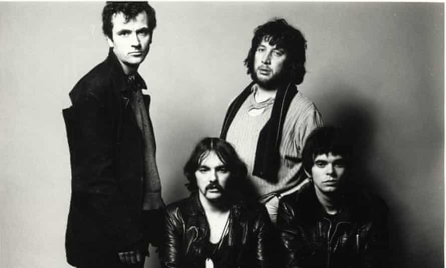 Defiant … the Stranglers, with Dave Greenfield seated middle.