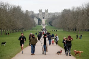 Windsor, UK: people and their dogs are seen on the Long Walk