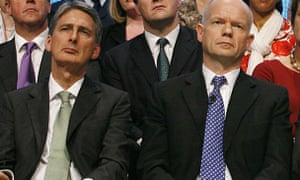 Philip Hammond and William Hague sit next to each other, both leaning in the same direction