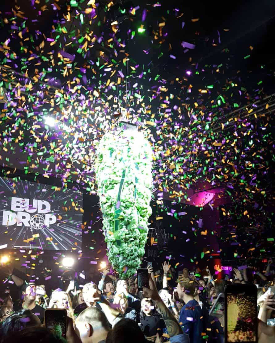 A decoration resembling a giant marijuana bud drops towards the crowd at midnight.
