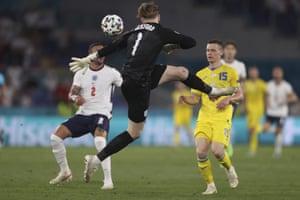 England's goalkeeper Jordan Pickford slices a clearance.