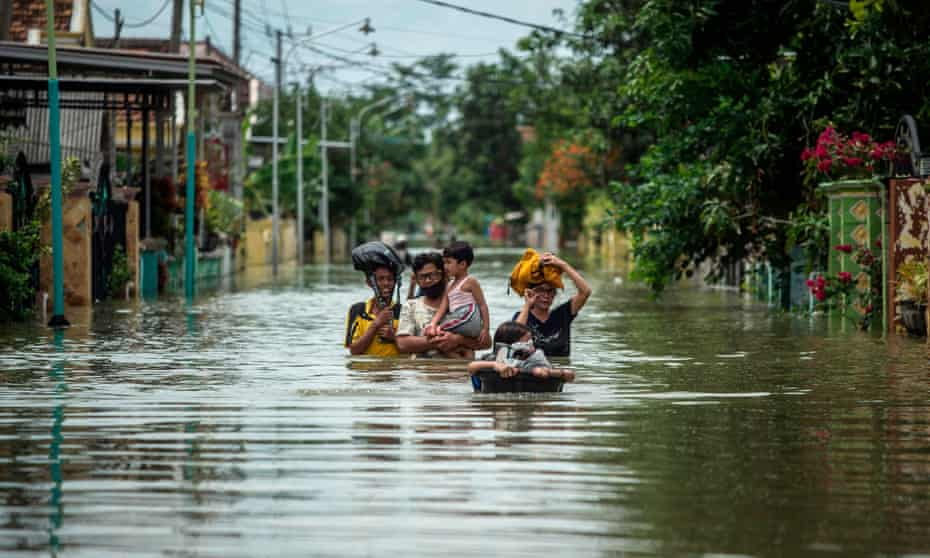 Residents of Java, Indonesia, evacuate their homes, December 2020.