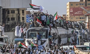 Protesters from the city of Atbara are cheered upon arriving at the Bahari station in Khartoum last month.