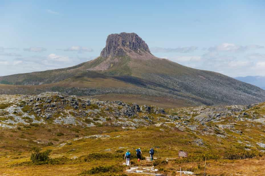 Hikers walking towards Barn Bluff on the overland track in Cradle Mountain Lake St Clair National Park, part of Tasmanian Wilderness, UNESCO World Heritage Site