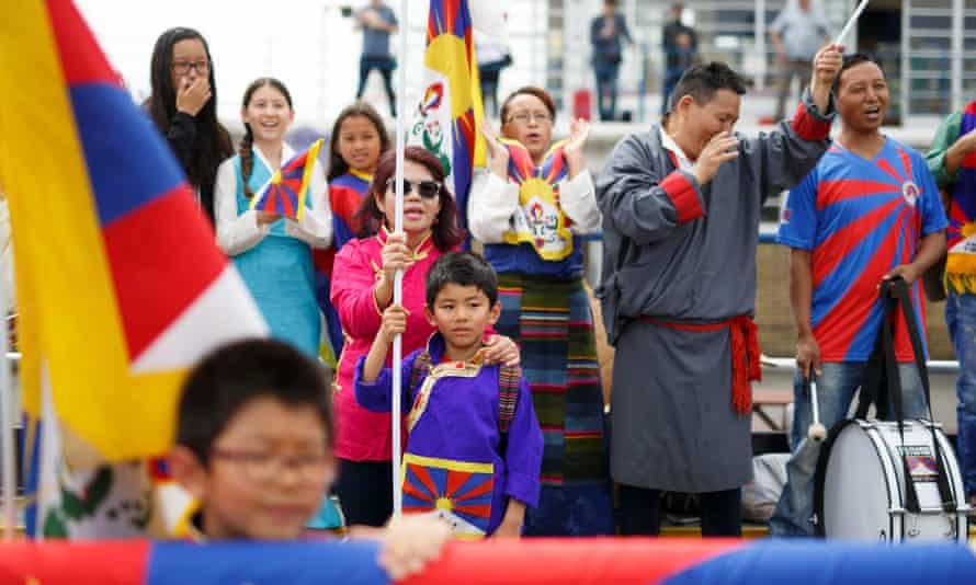 Tibetan fans show their colours at their game against Abkhazia at the Queen Elizabeth Stadium in Enfield.
