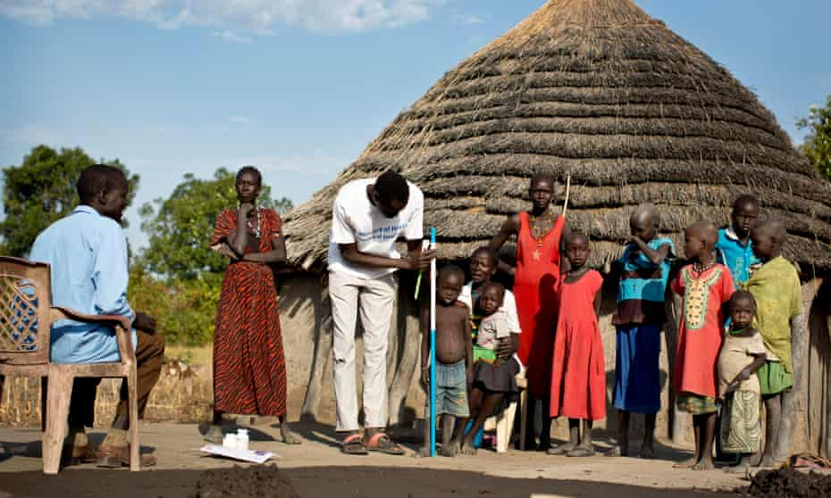 Unicef worker Daniel Madut screens children for signs of malnutrition in Angui, a village in Warrap state, South Sudan.