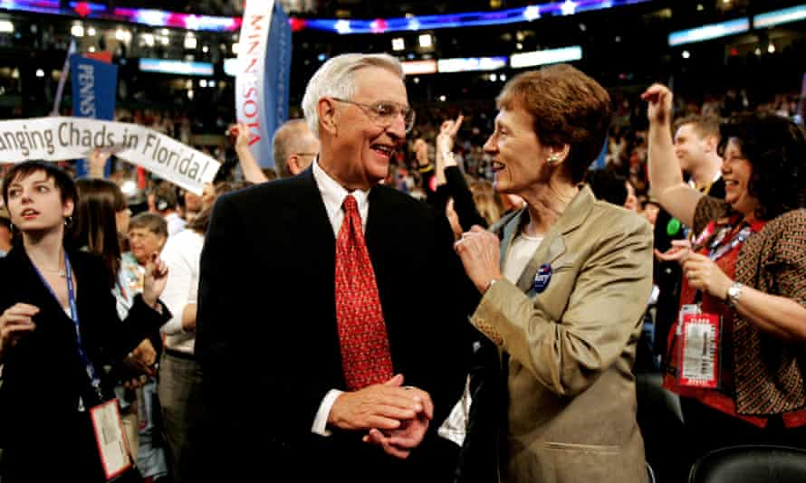 Mondale smiles with his wife, Joan, in the Minnesota delegation during the Democratic national convention in 2004.