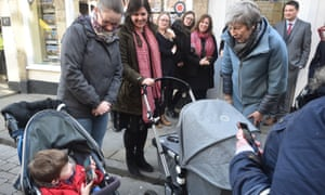 Prime Minister Theresa May talks to bystanders during a walk through Salisbury on the first anniversary of the Skripal poisoning.